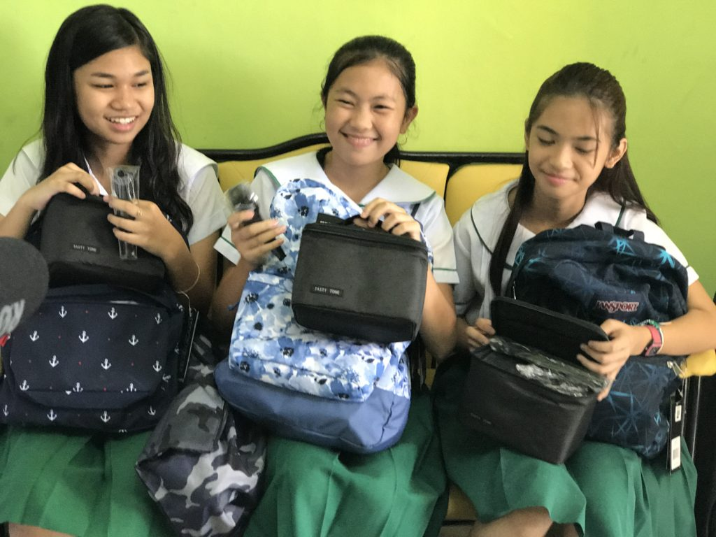 "Mariah Jen P. Lorenzo, Hailey Seloterio and Marinzki R. Victorio receive their ""Pabaon Package"" from Epson Philippines. The three students from Ninoy Aquino Elementary School were among the top winners in the Gift of Brightness Honor Roll essay-writing contest."